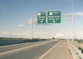 Pair of overhead signs, one for Alaska 2 northbound for Steese Expy, the other for Alaska 2 southbound for North Pole, Delta Jct