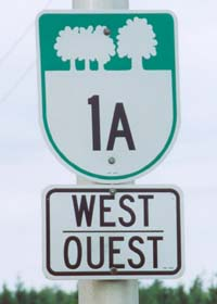 PEI route marker -- U-shaped cutout shield with trees on upper part