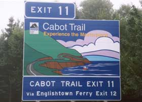 Cabot Trail exit sign: 'Experience the Masterpiece'