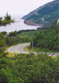 Cabot Trail rolling along the west Cape Breton coast, ocean on left