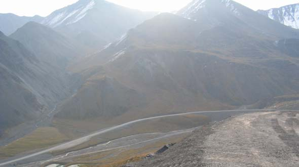 Dalton Highway northbound, descending from Atigun Pass summit