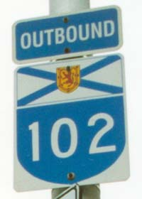 NS 102 outbound, closeup of arterial route marker with 'Outbound' banner