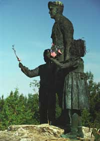 Silent Witness statue, with boy and girl flanking soldier